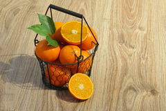 Clementines in a basket Stock Photo