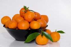 Clementines in black bowl. On white background Stock Photo