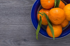 Clementines is a blue bowl Royalty Free Stock Photography