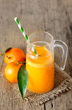 Clementines and a glass of juice Royalty Free Stock Images