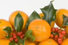 Clementines and holly Stock Photo