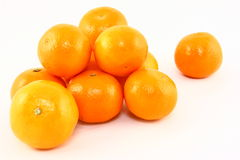 Clementines Isolated On White. A pile of fresh orange clementine fruits isolated on a white background Royalty Free Stock Images