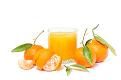 Clementines juice isolated. With leaves on white background Royalty Free Stock Photos