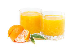 Clementines juice isolated. With leaves on white background Royalty Free Stock Images