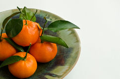 Clementines with leaf Stock Photography