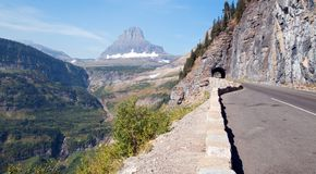 CLEMENTS MOUNTAIN AT THE TOP OF LOGAN PASS ON THE GOING TO THE SUN HIGHWAY UNDER CIRRUS CLOUDS IN GLACIER NATIONAL PARK USA. CLEMENTS MOUNTAIN AT THE TOP OF royalty free stock photos