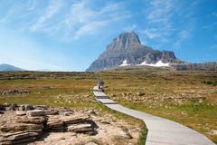 CLEMENTS MOUNTAIN TOWERING ABOVE HIDDEN LAKE HIKING TRAIL ON LOGAN PASS DURING 2017 FALL FIRES IN GLACIER NATIONAL PARK MONTANA US stock photos