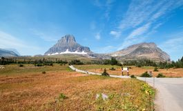 CLEMENTS MOUNTAIN TOWERING ABOVE HIDDEN LAKE HIKING TRAIL ON LOGAN PASS DURING 2017 FALL FIRES IN GLACIER NATIONAL PARK MONTANA US. CLEMENTS MOUNTAIN TOWERING stock image