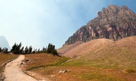 CLEMENTS MOUNTAIN TOWERING ABOVE HIDDEN LAKE HIKING TRAIL ON LOGAN PASS DURING 2017 FALL FIRES IN GLACIER NATIONAL PARK MONTANA US. CLEMENTS MOUNTAIN TOWERING royalty free stock photography