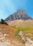 CLEMENTS MOUNTAIN TOWERING ABOVE HIDDEN LAKE HIKING TRAIL ON LOGAN PASS DURING 2017 FALL FIRES IN GLACIER NATIONAL PARK MONTANA US stock image