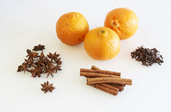 Clemmentines and spices, cinnamon, cloves and star anise Royalty Free Stock Images