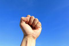 Clenched fist in the air Stock Images
