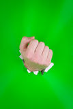 Clenched fist on green Stock Images