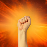 Clenched fist held high in protest Royalty Free Stock Photo