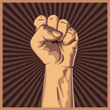 Clenched fist held high in protest background Stock Photography