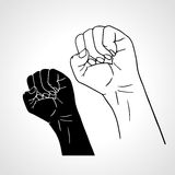 Clenched fist held high in protest. Outline and Stock Photo