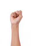 A clenched fist held high in protest Royalty Free Stock Images