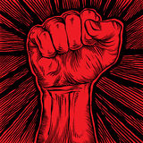 Clenched fist held high in protest. Royalty Free Stock Image