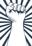 Clenched fist held high in protest. Royalty Free Stock Images