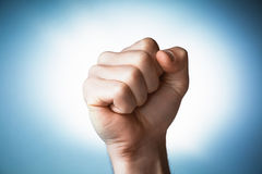Clenched fist held in protest. Youth solidarity Stock Image