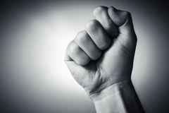 Clenched fist held in protest. Youth solidarity Stock Photography