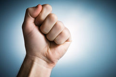 Clenched fist held in protest. Youth solidarity Royalty Free Stock Image