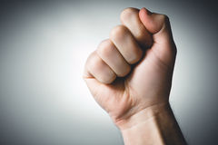 Clenched fist held in protest. Youth solidarity Royalty Free Stock Photography