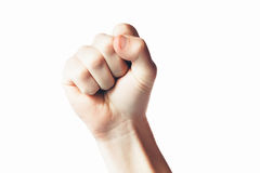 Clenched fist held in protest. Youth solidarity isolated on white background Stock Images