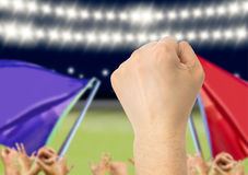 Clenched fist and victory. Fans support their team and celebrate goal score victory .The screen content is designed by me and not is copyrighted by others and Stock Photos
