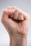 Clenched fist. On a white background Stock Photography