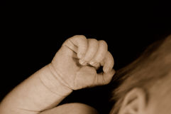 Clenched hand of newborn baby royalty free stock photography