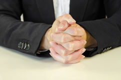 Clenched hands. Over white office desk stock image