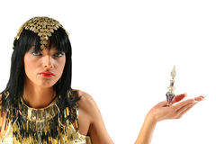 Cleopatra with parfume. Ancient egyptian queen Cleopatra with bottle of perfume stock image