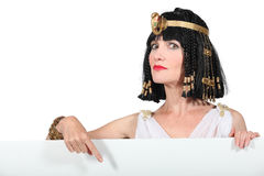 Cleopatra. Pointing at blank advertising board