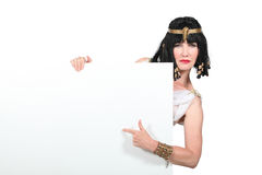 Cleopatra. Pointing at a blank sign stock image