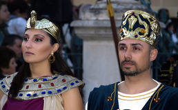 Cleopatra and Rameses. People dressed up as Egyptian rulers during reenactment of Biblical times. Good Friday procession in town of Luqa in Malta Europe Royalty Free Stock Image