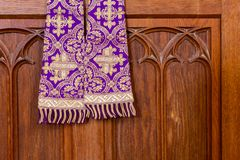 Clergy damask stole for priests and deacons, surplice maniple. Purple priest stole used for confessions, vestment purple and gold as worn during confession and royalty free stock images