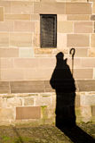 Clergyman casts shadow Stock Photos