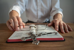 Clergyman with prayer book and crucifix. Stock Photo