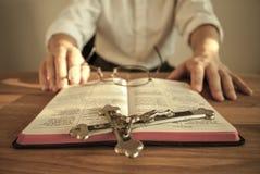 Clergyman with prayer book and crucifix No. 2 Stock Photos