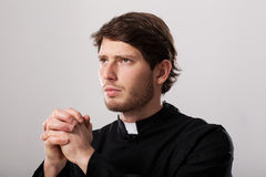 Clergyman praying Royalty Free Stock Photo