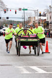 Clergymen Push Holy Rollers Bed In Annual Fundraiser Race Stock Photography