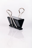 Clerical clip. Black clerical clip for paper on white background stock image