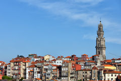 Clerigos Church Tower and Houses in Porto. City of Porto Old Town Skyline, Clerigos Church tower on the right, traditional Portuguese houses Royalty Free Stock Photography