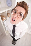 Clerk with big glasses astonished Royalty Free Stock Images