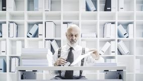 Clerk doing a boring job in the office royalty free stock photography