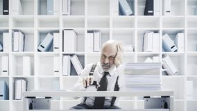 Clerk doing a boring job in the office stock photography
