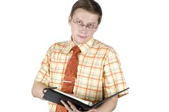 Clerk holding notebook. Young businessman, wearing elegant shirt and tie. Holding black notebook, busy with his work Stock Photos