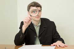 Clerk at office with magnifier Stock Image