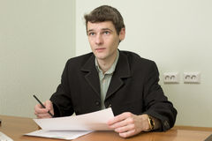Clerk at office sits at a desktop Royalty Free Stock Photo